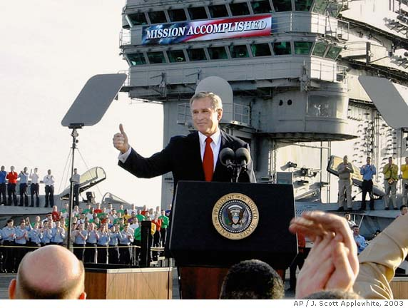 "George W. Bush - battleship USS Abraham Lincoln: ""Mission Accomplished!"""
