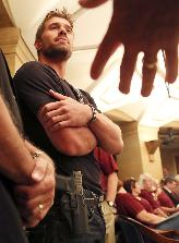 Glock owner at State Capitol hearing. Photo by David Joles, StarTribune.