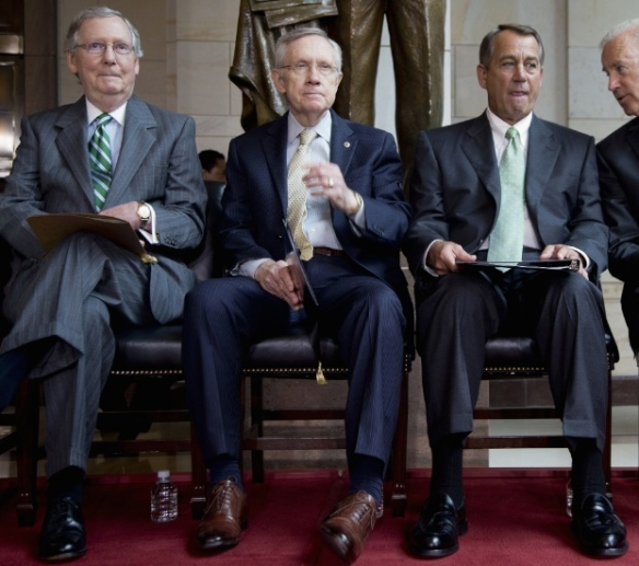 Sen. Mitch McConnell, Sen. Harry Reid (with the turned-in left foot), and Speaker of the House John Boehner.