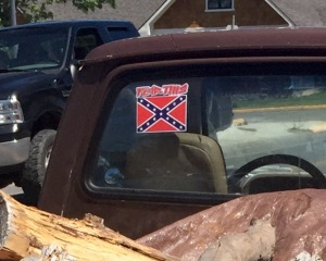 The pickup truck with the Confederate Flag decal