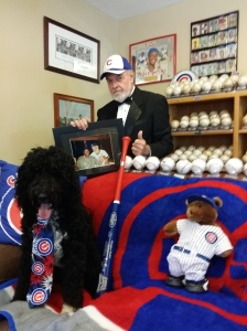 Harry Strong holding picture with Mr. Cub, Ernie Banks and Cubs memorabilia.