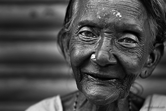 Black and white portrait of an old woman with an angelic smile from Trivandrum, Kerala