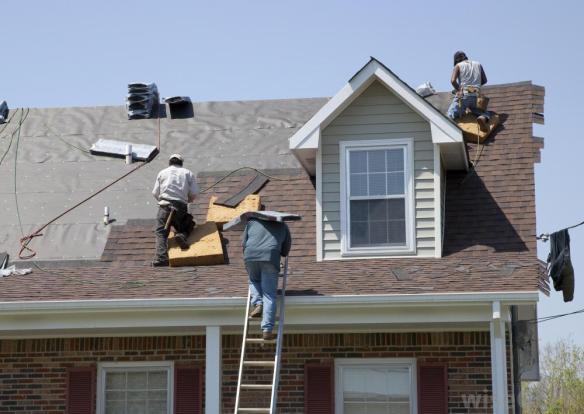 men-putting-shingles-on-house