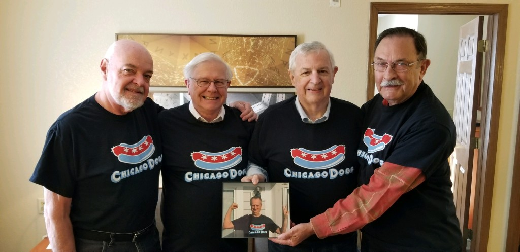 Photograph of four 'Old Dogs' with holding a picture of Wayne Boulton.