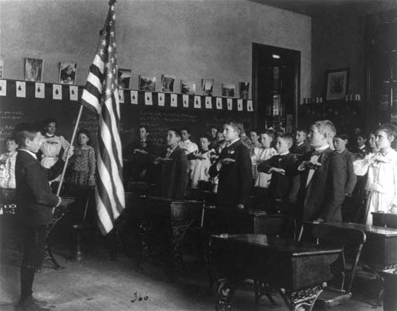 Photo of school children reciting the American Pledge of Allegiance.
