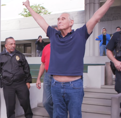 photo of Roger Stone flashing his Nixon V-sign after his indictment.