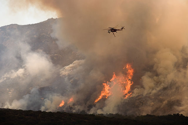 FEMA photograph of helicopter fighting California forest fire.