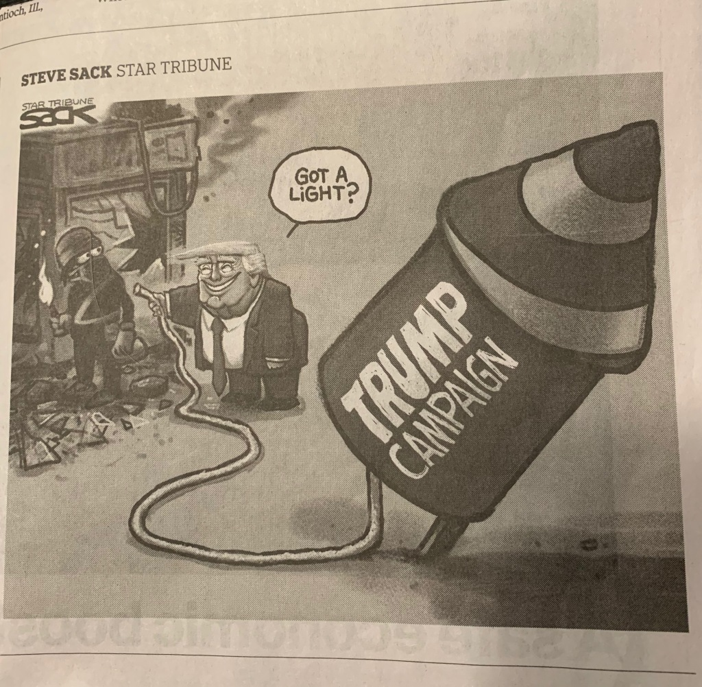 "Steve Sack cartoon showing a person a man in black standing in the rubble left from a riot, holding a torch, and broadly grinning Donald Trump offering the rioter the fuse that that will ignite the fuel for his ""Trump Campaign"" rocket."